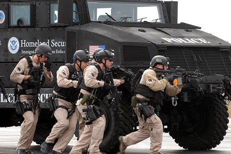 Photo of ICE Police with Armored Truck