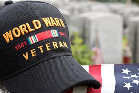 Photo of World War II Veteran hat and American flag