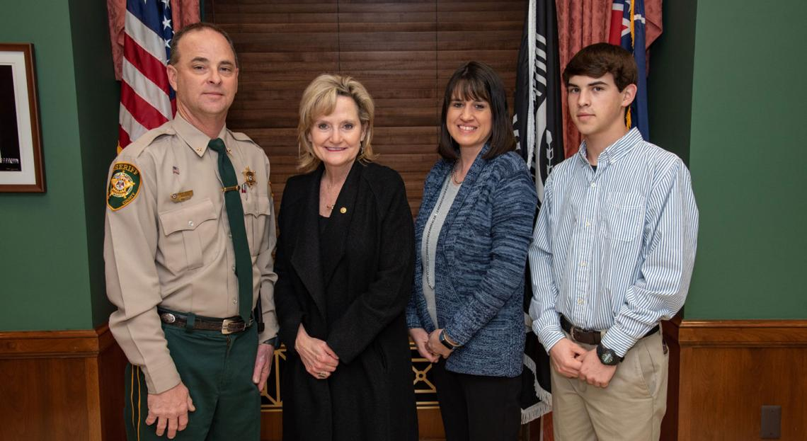 Senator Hyde-Smith visits with Clay County Sheriff Eddie Scott, his wife Lorie, and son Bradley