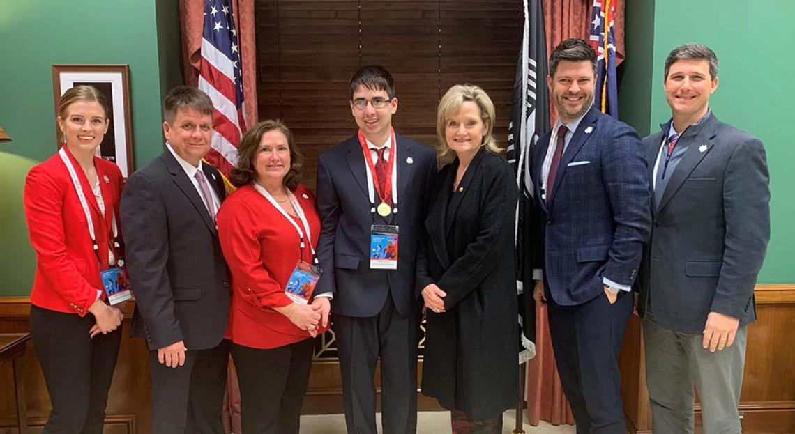 Senator Hyde-Smith congratulates Brooks Chance of Ridgeland and Mississippi Special Olympics advocates